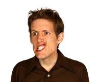 Hombre que tira de una cara de Strang Imágenes de archivo libres de regalías