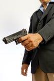 Hombre que tira un arma Imagen de archivo libre de regalías