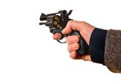 Hombre que tira una arma de mano imagen de archivo libre de regalías