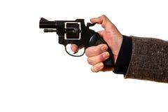 Hombre que tira una arma de mano fotografía de archivo