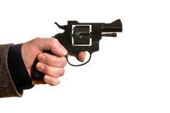 Hombre que tira una arma de mano imagen de archivo