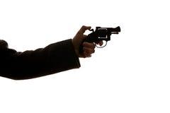 Hombre que tira una arma de mano fotografía de archivo libre de regalías