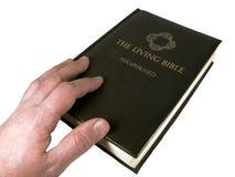 Hombre que toca la biblia Fotografía de archivo