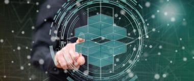 Hombre que toca un concepto del blockchain imagenes de archivo