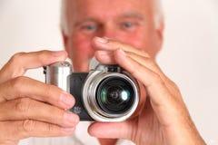 Hombre que toma el cuadro Foto de archivo libre de regalías