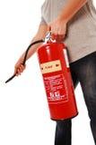Hombre que usa el extintor Fotografía de archivo