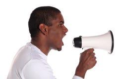 Hombre que usa el megáfono Fotografía de archivo