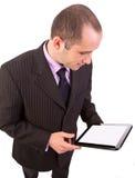 Hombre que usa una PC del panel táctil imagen de archivo