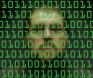 Hombre que vigila código binario Fotos de archivo libres de regalías