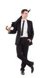 Hombre relajado de la elegancia que presenta con un paraguas Fotografía de archivo