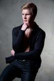 Hombre rubio joven que piensa en algo Fotografía de archivo libre de regalías