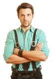 Hombre serio en los pantalones de cuero Imagen de archivo libre de regalías