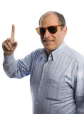 Hombre sonriente con el dedo que señala el número uno Imagen de archivo