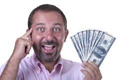 Hombre sonriente con las cuentas de $ 100 Imagen de archivo libre de regalías