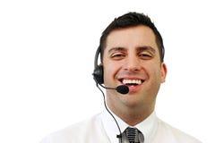 Hombre sonriente del servicio de atención al cliente imagen de archivo