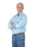 Hombre sonriente en pantalones vaqueros y camisa del trabajo Fotos de archivo