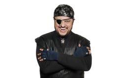 Hombre sonriente en un traje del pirata Imagenes de archivo