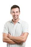 Hombre sonriente feliz ocasional joven Imagen de archivo libre de regalías