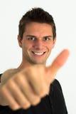 Hombre sonriente feliz que hace los pulgares para arriba fotografía de archivo libre de regalías