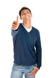 Hombre sonriente que muestra el pulgar para arriba Foto de archivo libre de regalías