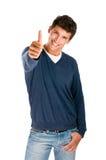 Hombre sonriente que muestra el pulgar para arriba Foto de archivo