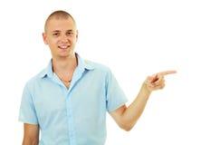 Hombre sonriente que señala a un lado Fotos de archivo libres de regalías