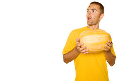 Hombre sorprendido con una calabaza Foto de archivo libre de regalías