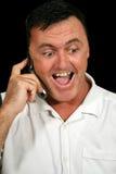 Hombre sorprendido del teléfono celular fotografía de archivo