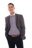 Hombre suave sonriente en una corbata de lazo Imagenes de archivo