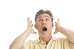 Hombre temeroso que mira para arriba mientras que gesticula Imágenes de archivo libres de regalías