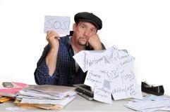Hombre tensionado hacia fuera sobre cuentas Imagen de archivo libre de regalías
