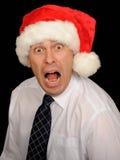 Hombre tensionado que desgasta el sombrero de Santa Imágenes de archivo libres de regalías