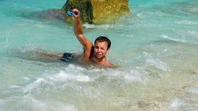 Hombre tomado abajo por la onda Imagen de archivo libre de regalías