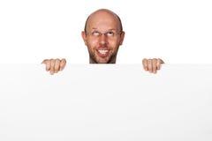 Hombre tonto divertido que lleva a cabo la muestra Fotografía de archivo libre de regalías