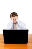 Hombre triste con el ordenador portátil Fotografía de archivo