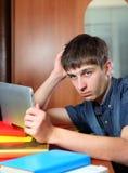 Hombre triste con la tableta Fotografía de archivo libre de regalías