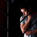 Hombre triste detrás de barras que piensa en algo Imagen de archivo
