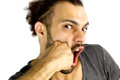 Hombre triste que consigue el sacador en cara Foto de archivo libre de regalías