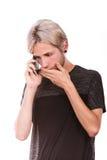 Hombre triste que habla en el teléfono móvil Fotos de archivo
