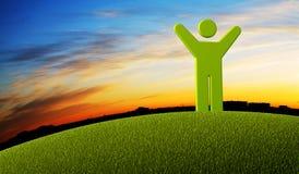 Hombre verde del símbolo que se coloca en la tierra Foto de archivo libre de regalías