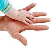 Hombre y bebé de la mano Imagen de archivo