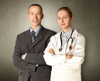 Hombre y doctor sonrientes de negocios Imagen de archivo libre de regalías