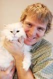 Hombre y gato Foto de archivo