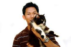 Hombre y gato Foto de archivo libre de regalías