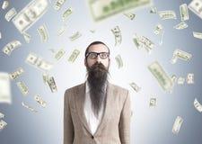 Hombre y lluvia desconcertados del dólar Imagen de archivo libre de regalías