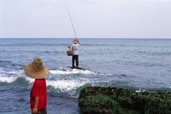Hombre y muchacho de Fisher Fotos de archivo libres de regalías