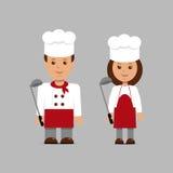 Hombre y mujer bajo la forma de cocineros Imágenes de archivo libres de regalías