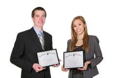 Hombre y mujer con los certificados Fotos de archivo