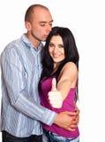 Hombre y mujer con los pulgares-para arriba Foto de archivo libre de regalías