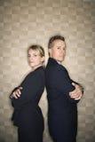 Hombre y mujer de negocios de nuevo a la parte posterior Imagenes de archivo